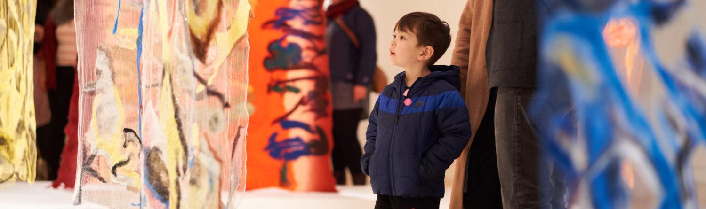 Boy looking at art installation